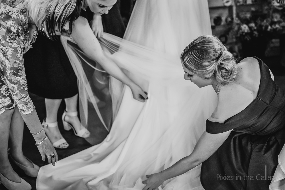 bridesmaids wedding dress final touches black and white photo