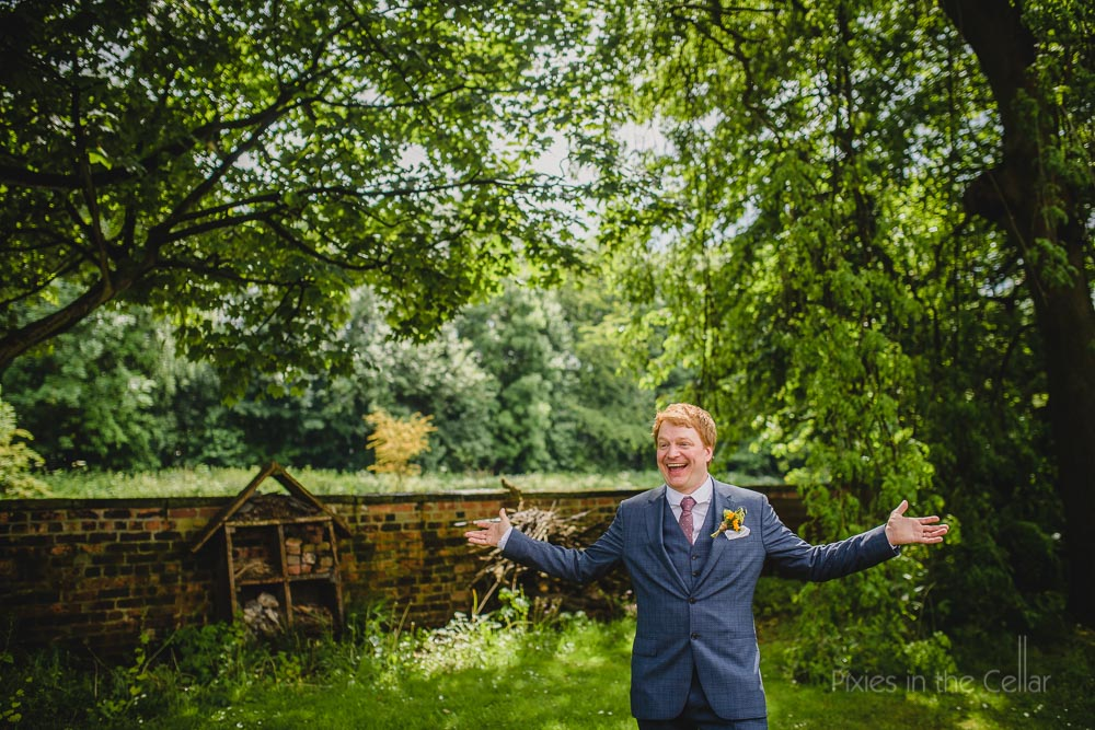 summer rustic wedding groom alone