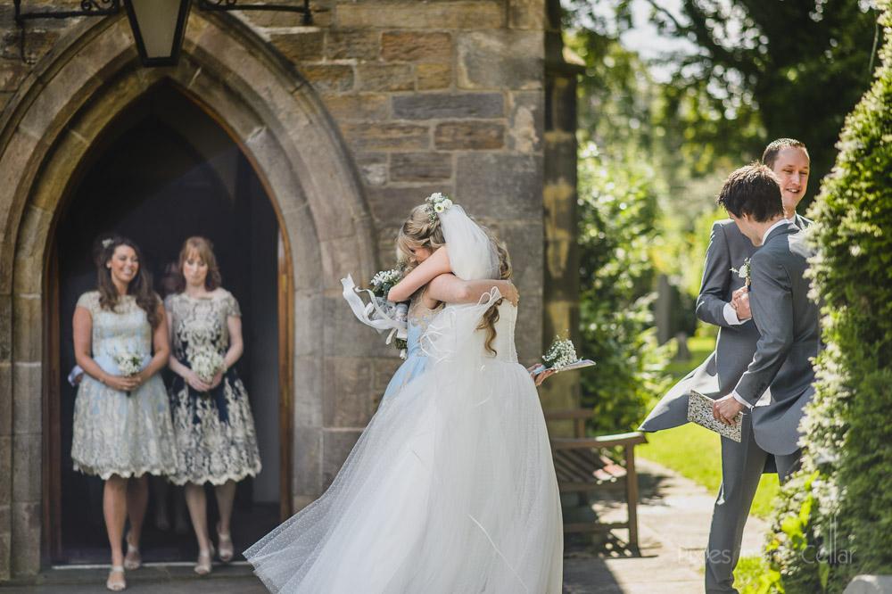 Just married hugs English church wedding photo