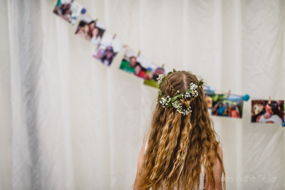 girl engaged in photo display wedding marquee