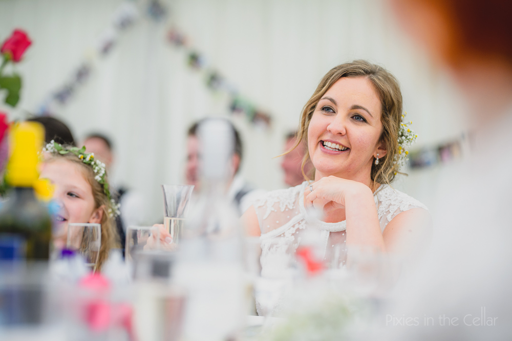 bride during wedding speeches in marquee
