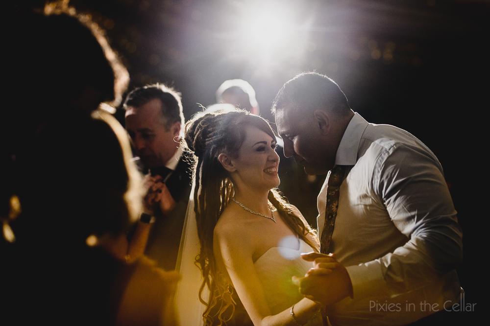 bride with dreadlocks dancing
