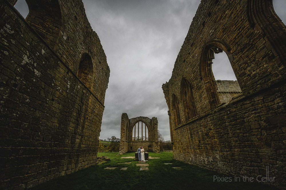 UK abbey wedding couple
