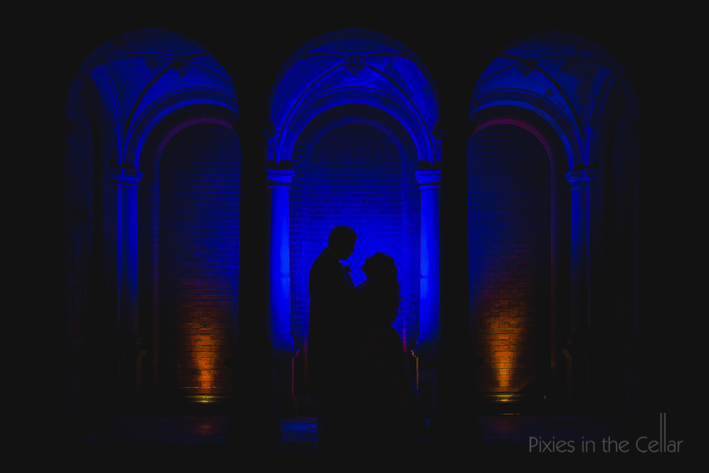 alternative dark wedding photography blue pillars