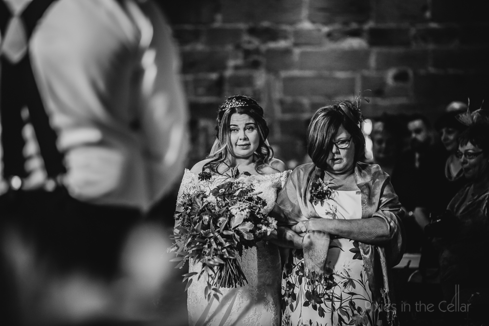 bride and mum walking down aisle
