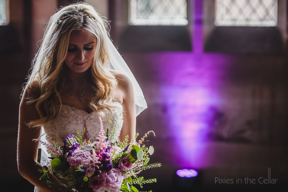 bride pinks purples veil back light