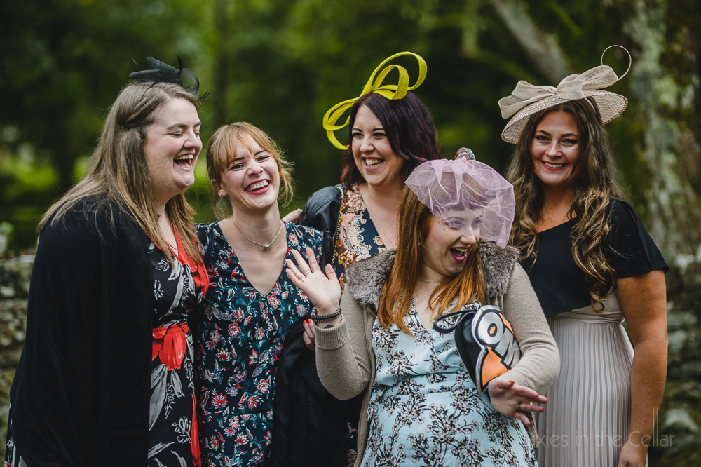 best friends at weddings hats, fascinators, smiles