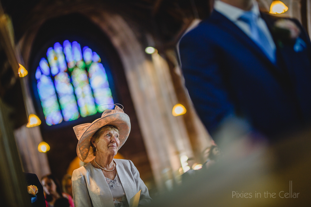 wedding guest and hat in church