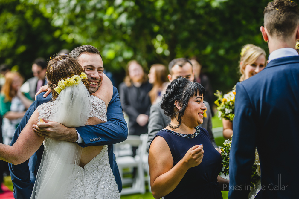 hugs from bridesman