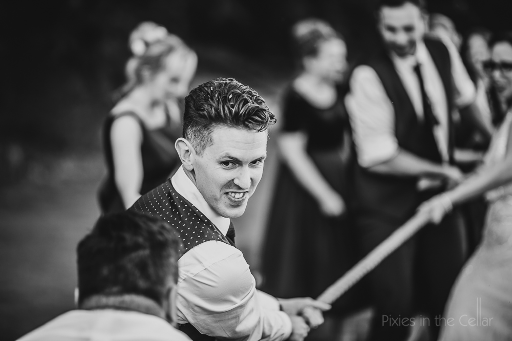 groom wedding tug of war photo