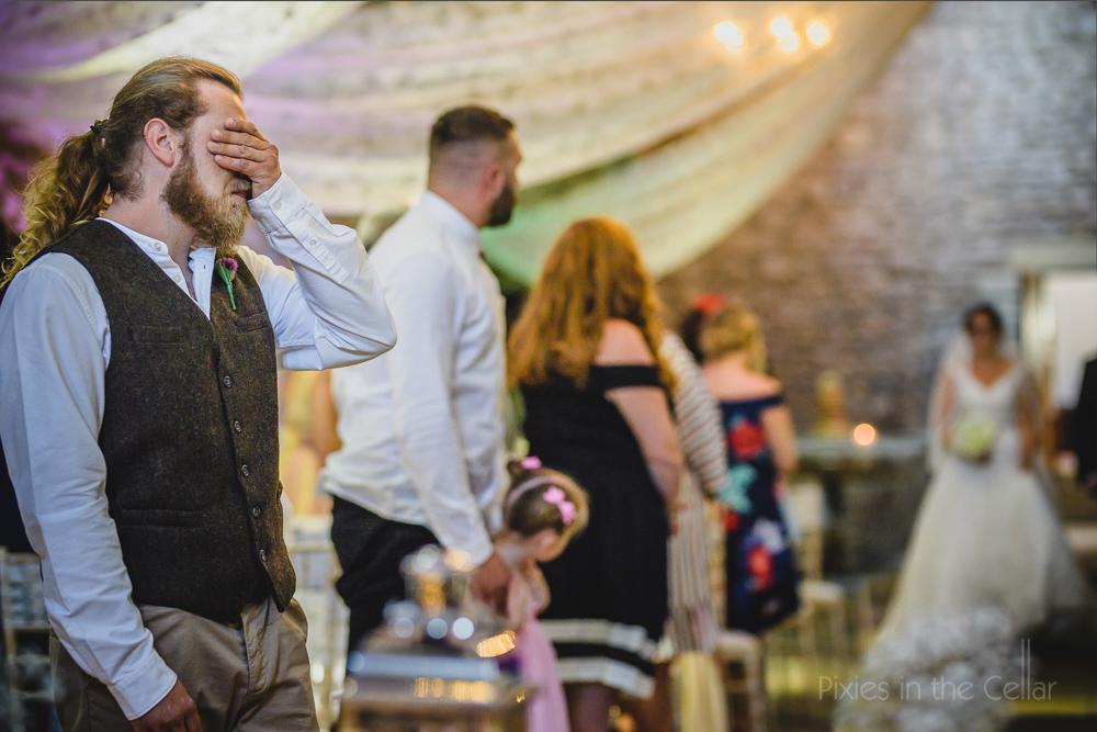 groom as bride walks down aisle