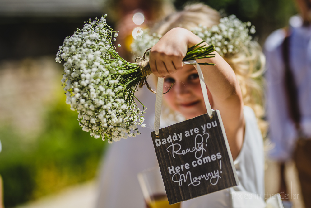 flower girl gypsophila bouquet and sign
