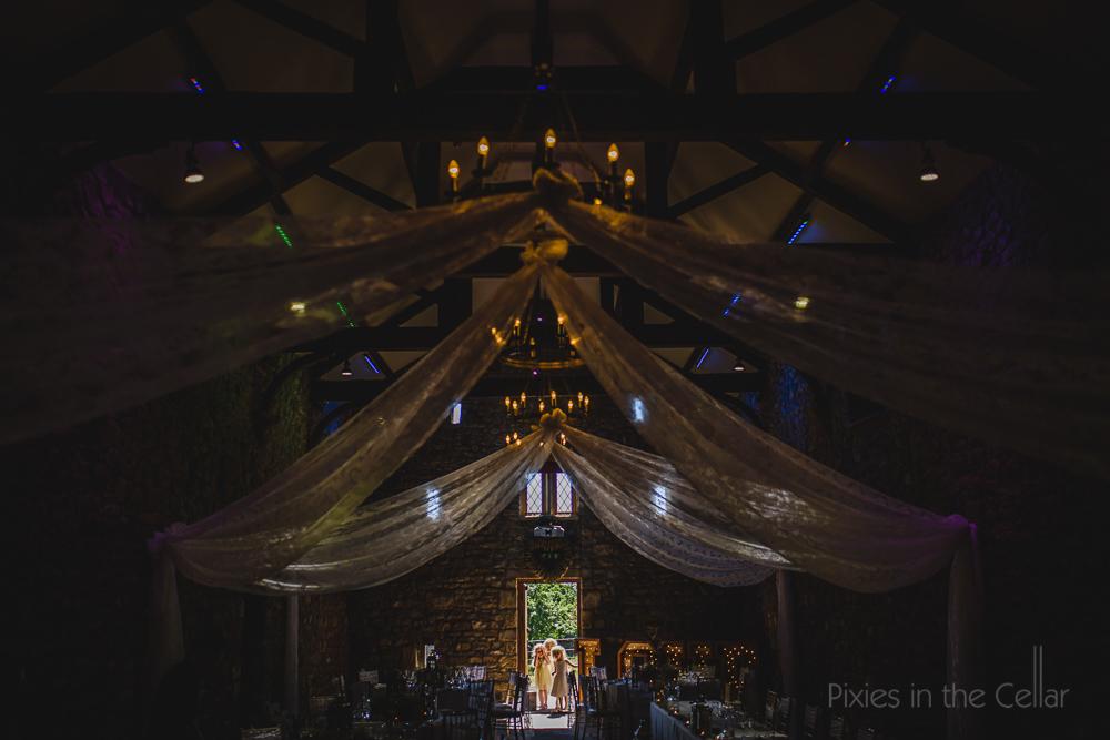 barn rustic wedding with flower girls