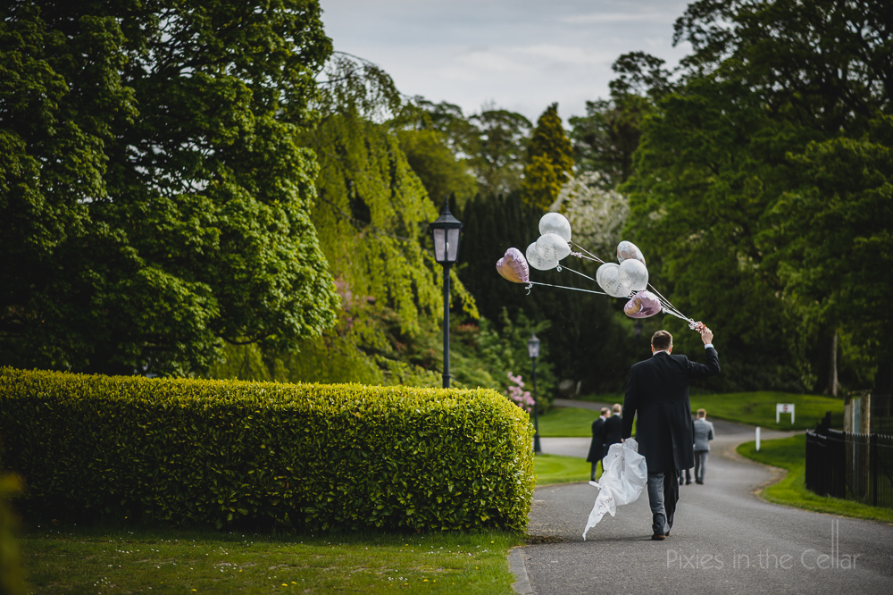 groom and balloons uk wedding photographers