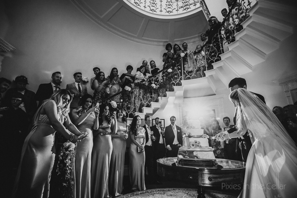 Cake cutting under stairs
