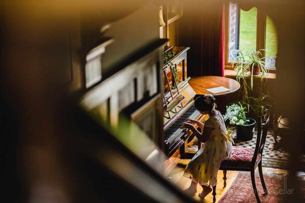Altrincham wedding photography garden party girl at piano