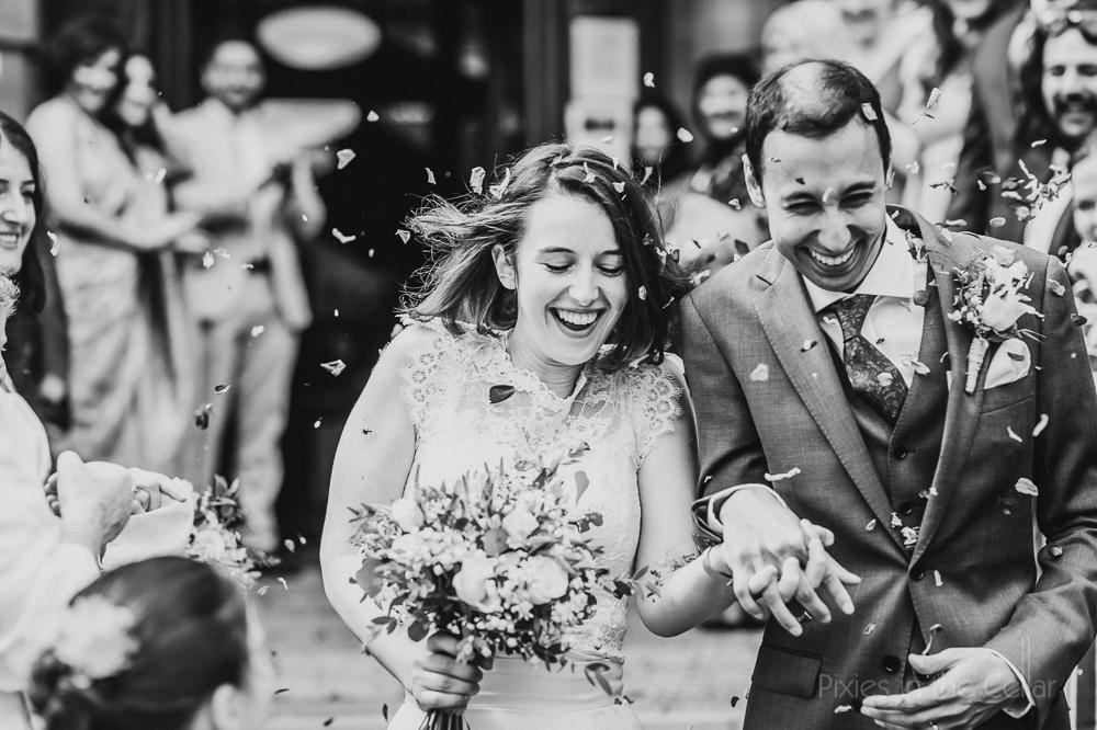 best UK wedding photography confetti smiles