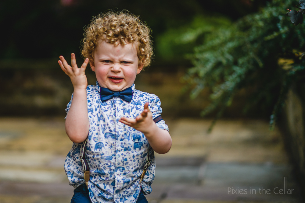child bow tie curly hair wedding