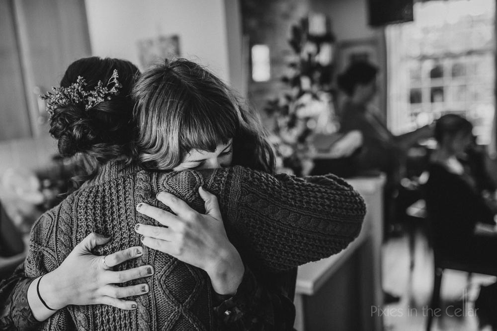 knitted jumper hugs wedding friends