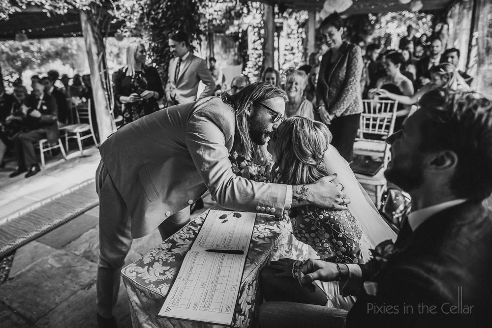 friends hugs wedding signing