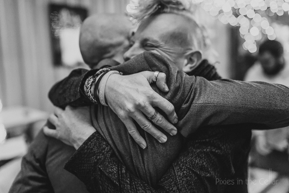 real friends wedding hugs