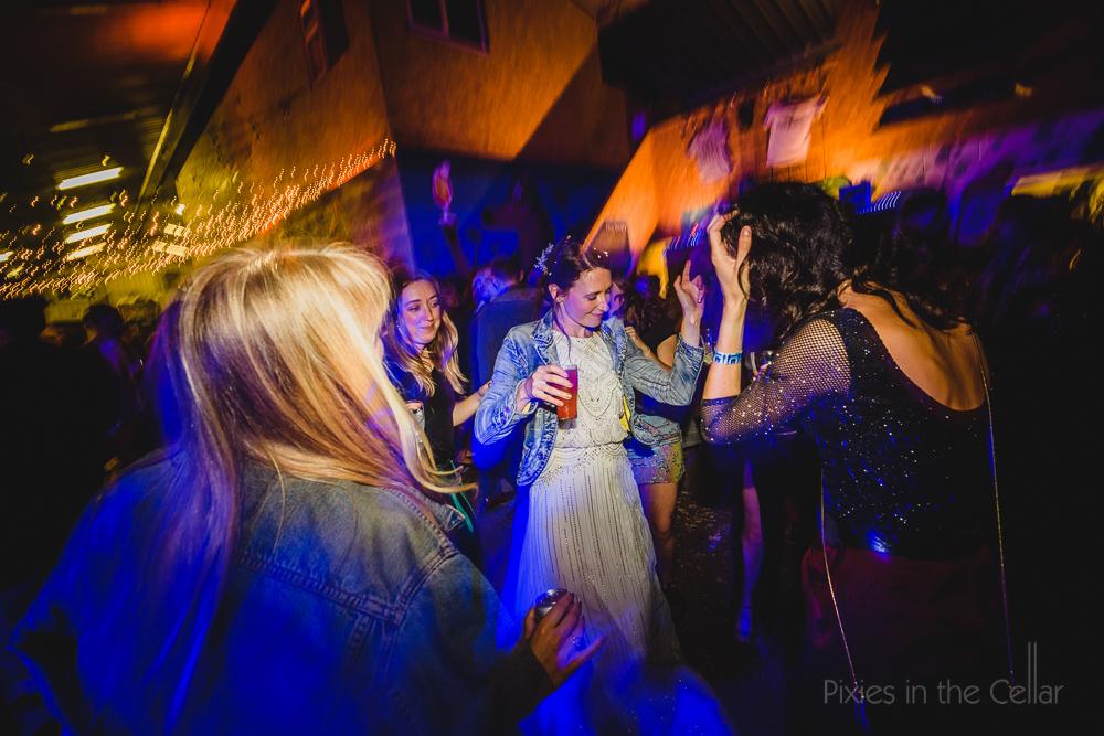 denim jacket and wedding dress urban cool look
