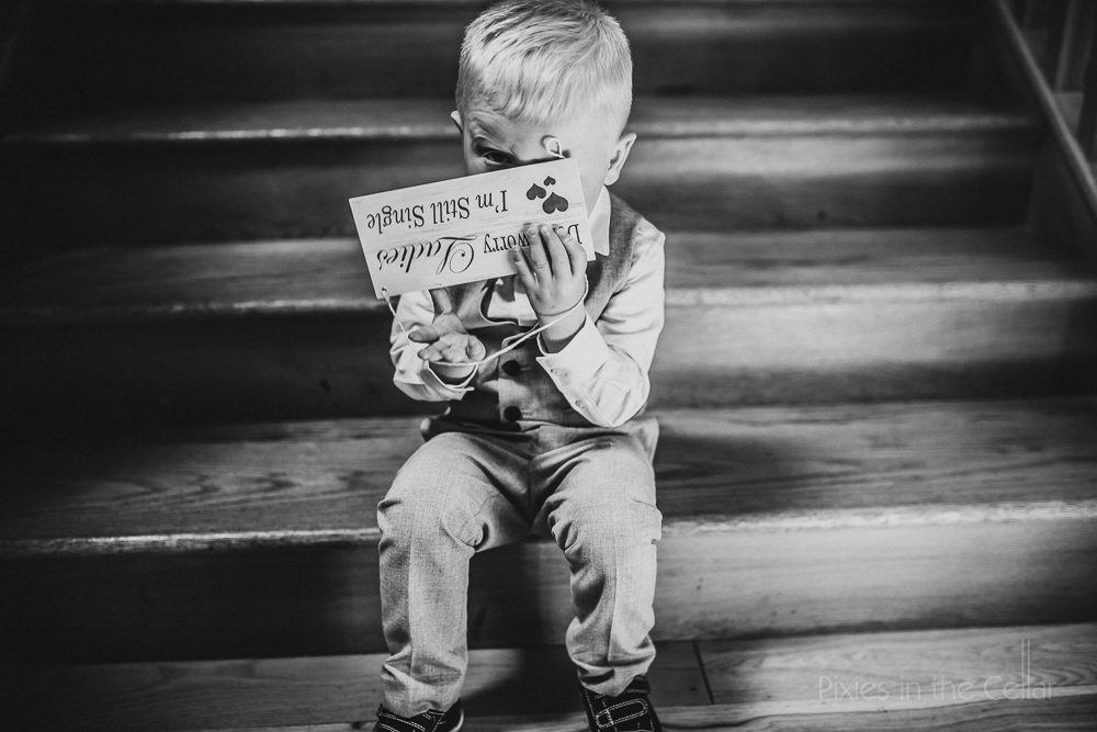 wedding page boy with sign