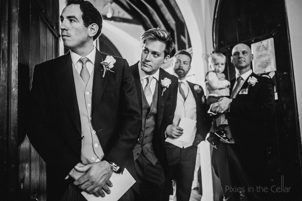 groomsmen at church wedding