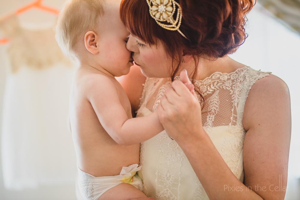 baby snd bride at wedding