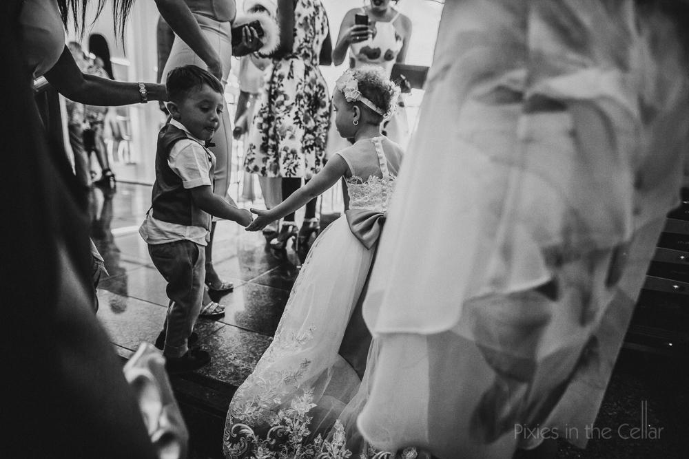 kids dancing at wedding black and white photo