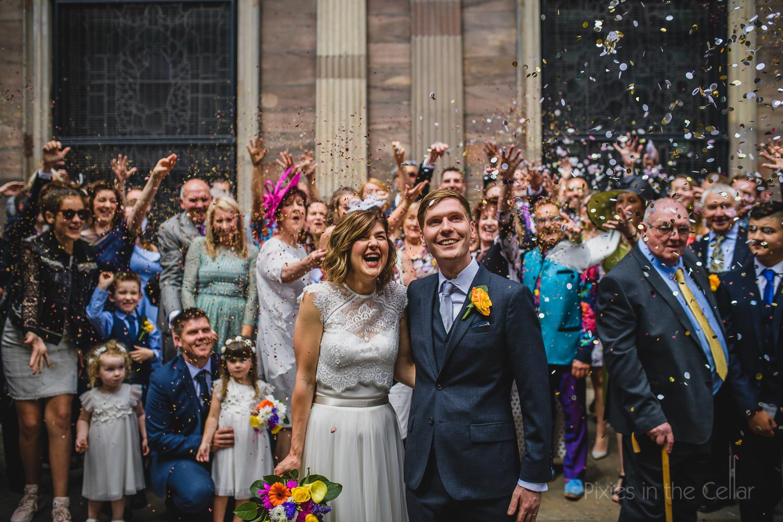 Confetti laughter city centre wedding Manchester