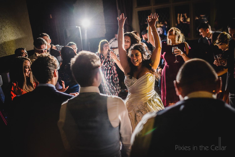 super happy bride on dance floor Cheshire wedding photography