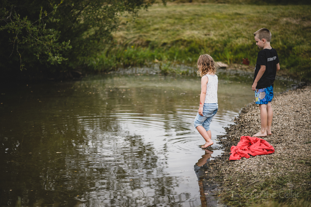 children by pond photo