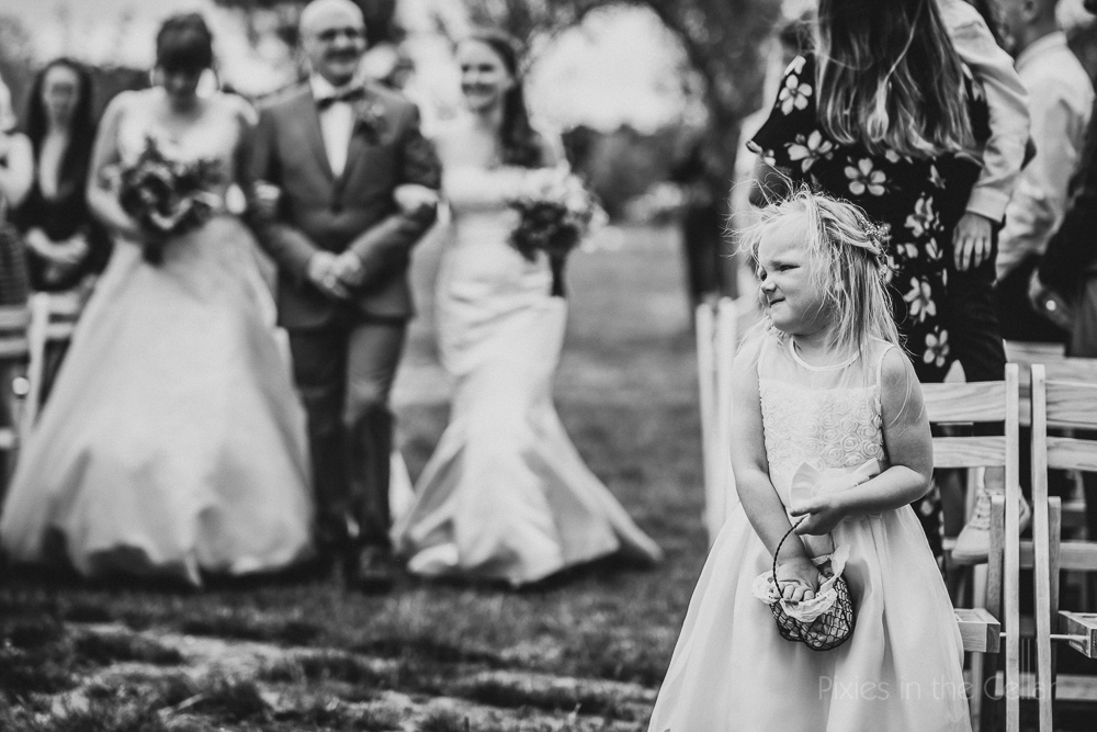 Flower girl outdoor wedding ceremony