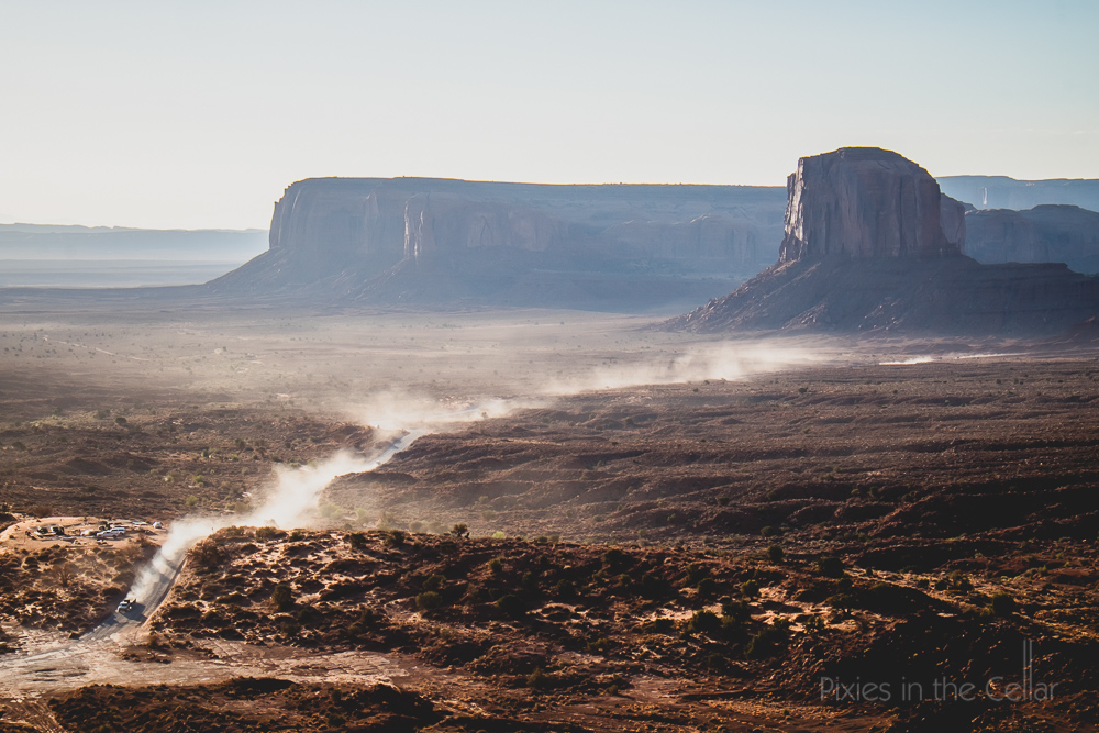 Road dust monument valley sunrise