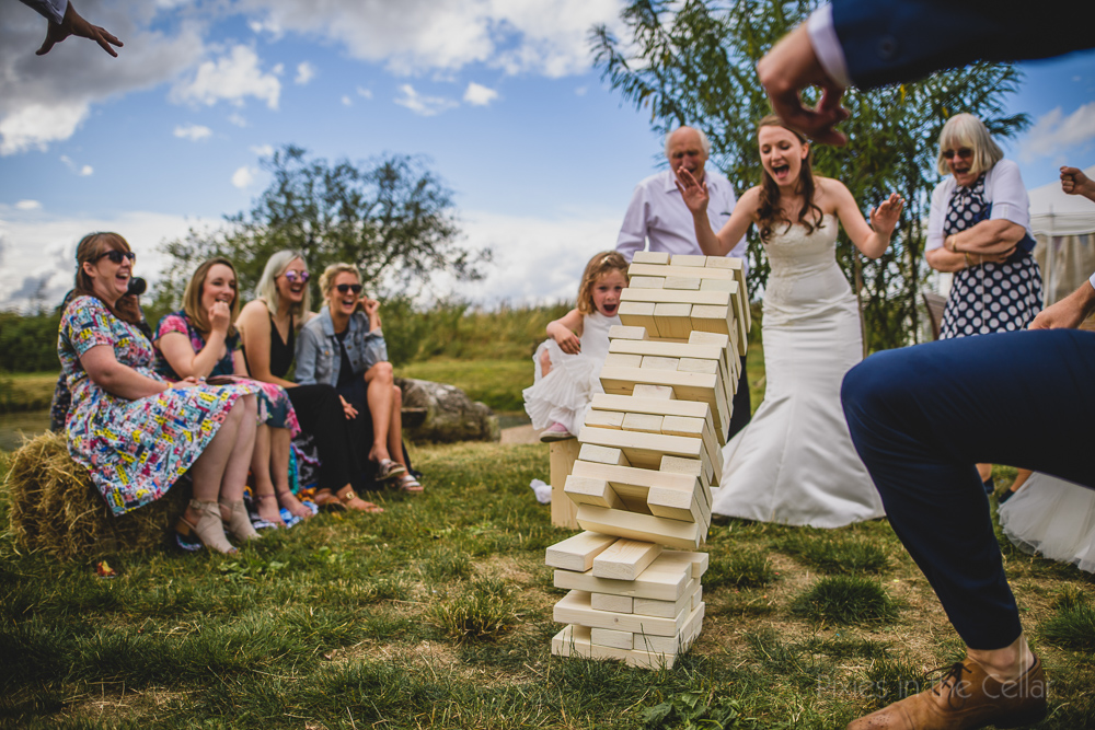 wedding jenga outdoor games relaxed photography
