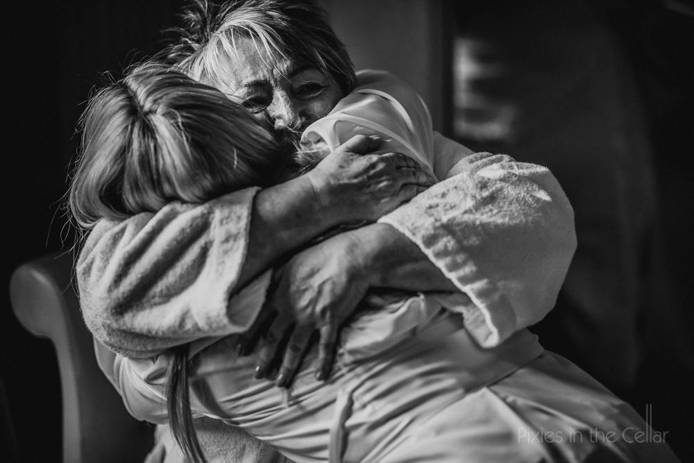 mum and daughter hug wedding day