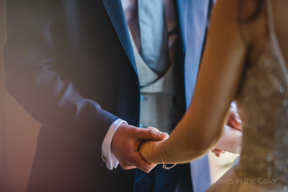 hands wedding ceremony