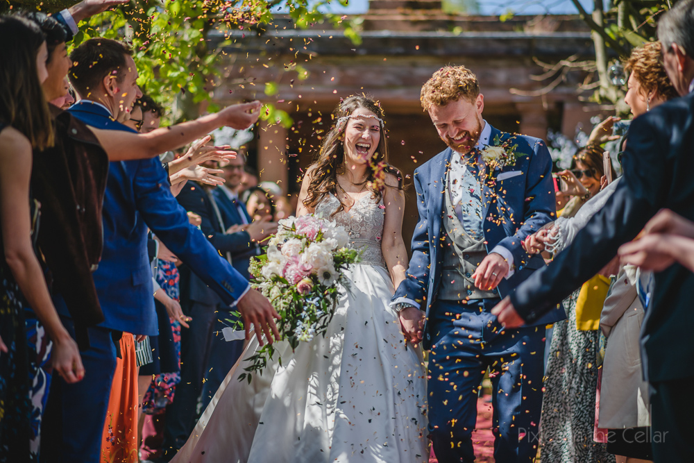 Confetti exit outdoor wedding ceremony