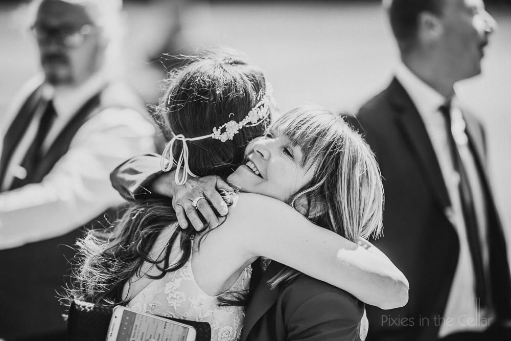 guest hugs bride