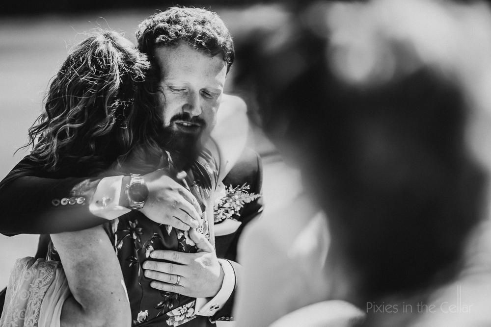 guest hugs groom
