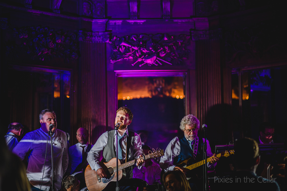 groom singing in wedding band