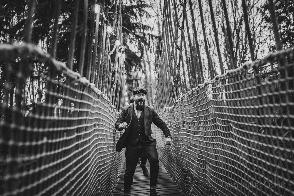vintage groom fun photography rope bridge