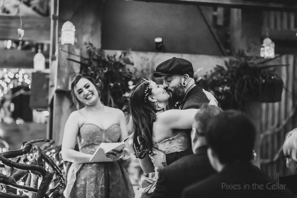 wedding first kiss flat cap groom vintage bride