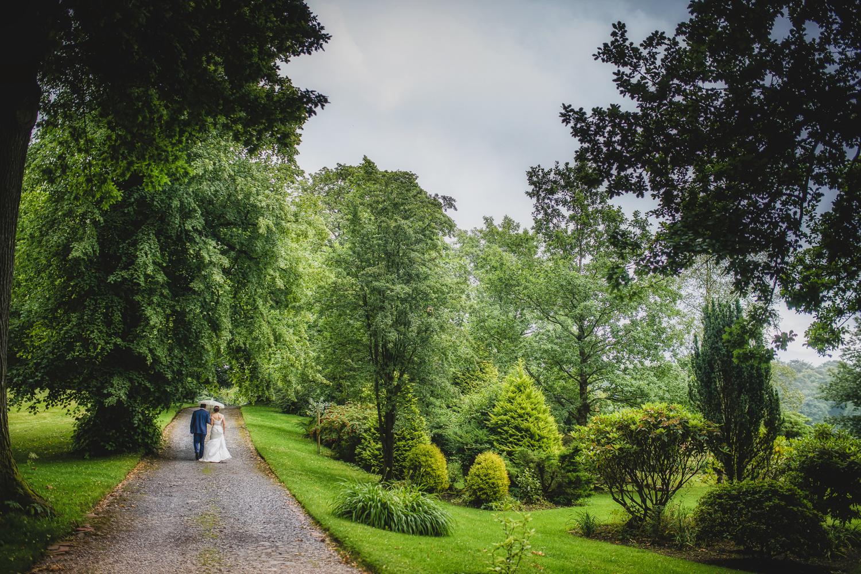 rainy wedding day umbrella England
