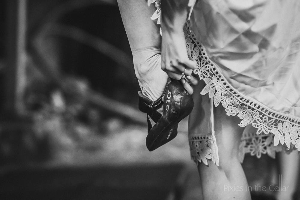climbers wedding bride in rock climbing shoes
