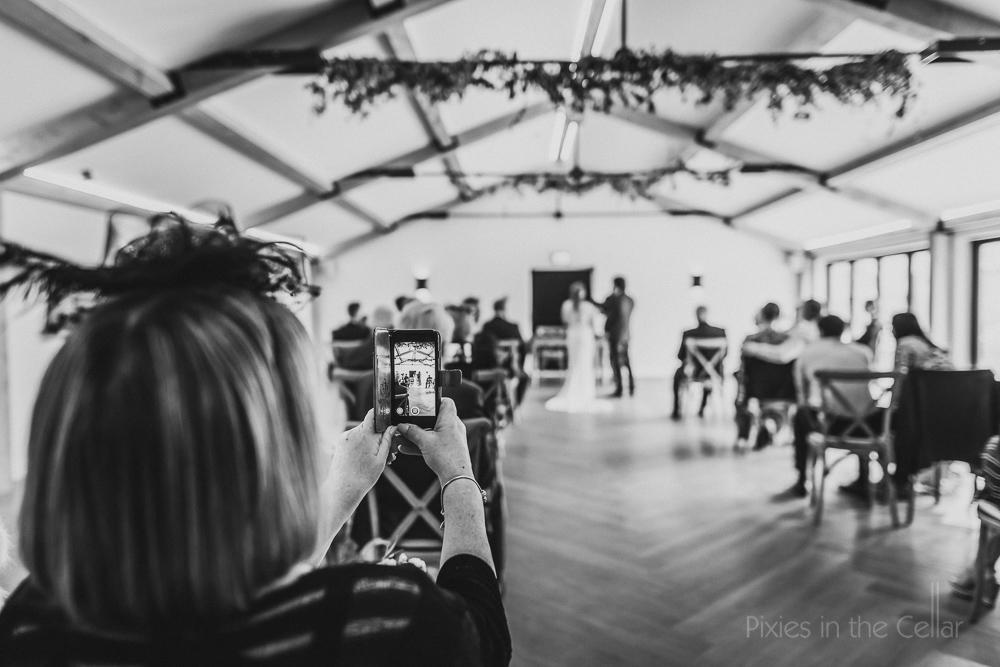 phones at weddings Hanbury Wedding Barn photography