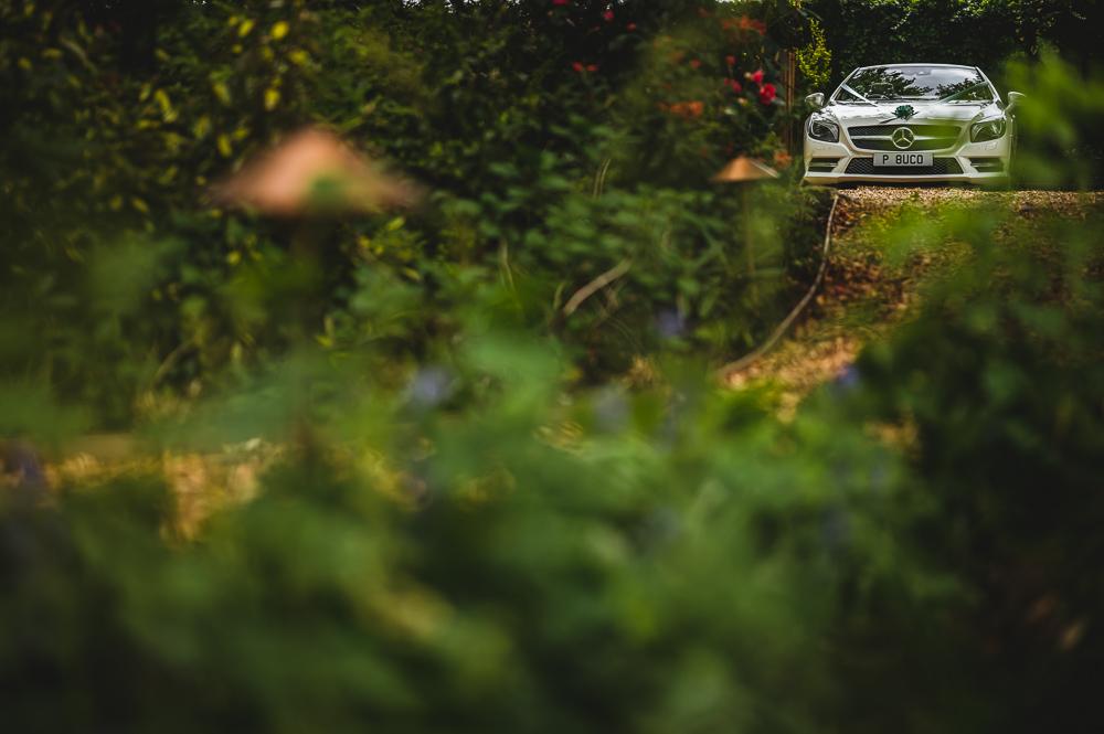 woodland wedding with car